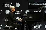 """December 21, 2016, Tokyo, Japan - Japanese composer Ryuichi Sakamoto, a member of the Yellow Magic Orchestra (YMO) plays piano after he received Montblanc de la Culture Arts Patronage Award in Tokyo on Wednesday, December 21, 2016. Sakamoto played his screen music """"Merry Christmas Mr. Lawrence"""" with young musicians.  (Photo by Yoshio Tsunoda/AFLO) LWX -ytd-"""