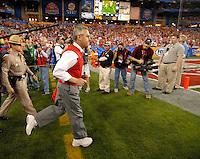 Jan 8, 2007; Glendale, AZ, USA; Ohio State Buckeyes head coach Jim Tressel runs onto the field before the BCS National Championship game at the University of Phoenix Stadium. Mandatory Credit: Mark J. Rebilas