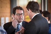 PQ MNAs Bernard Drainville and Pierre-Karl Peladeau chat during the presentation of parti Quebecois candidates for the upcoming byelection Tuesday May 5, 2015.<br /> <br /> PHOTO :  Francis Vachon - Agence Quebec Presse
