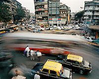 Public buses, cars and other traffic on Mohammed Ali Road in a Muslim quarter of the city centre. CHECK with MRM/FNA