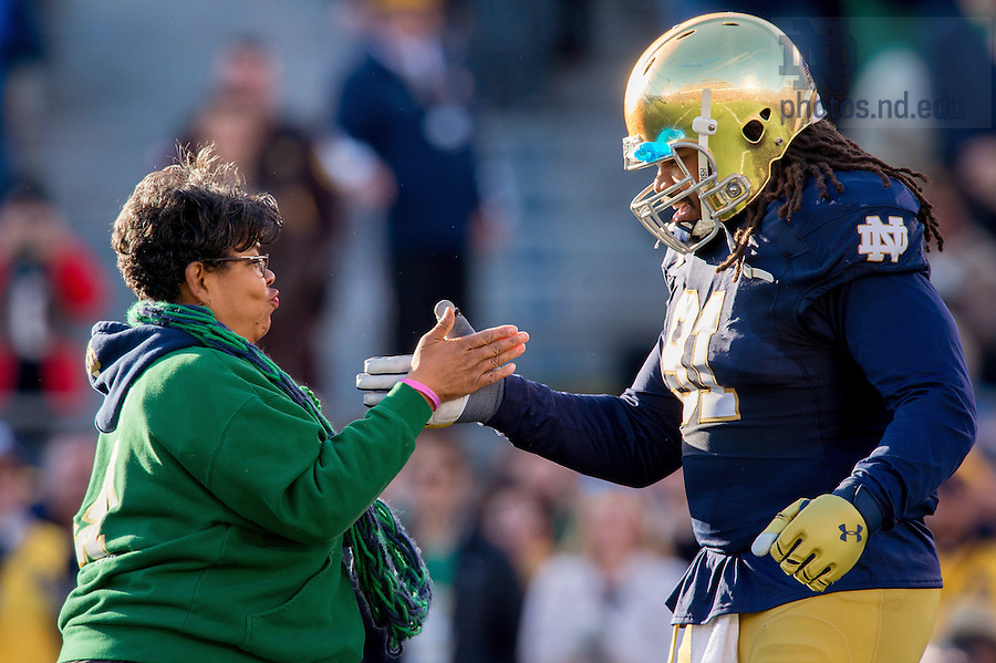 Nov. 14, 2015; Sheldon Day (91) greets his mother Carol Boyd during Senior Day ceremonies before the game against Wake Forest. (Photo by Matt Cashore)