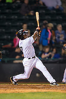 Andy Ibanez (7) of the Hickory Crawdads follows through on his swing against the Rome Braves at L.P. Frans Stadium on May 12, 2016 in Hickory, North Carolina.  The Braves defeated the Crawdads 3-0.  (Brian Westerholt/Four Seam Images)