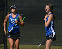 Rogers' Grace Lueders (left) and doubles partner JK Bohnert speak Tuesday, Oct. 12, 2021, as they compete in the 6A state tennis finals at Memorial Park in Bentonville. Visit nwaonline.com/211013Daily/ for today's photo gallery.<br /> (NWA Democrat-Gazette/Andy Shupe)