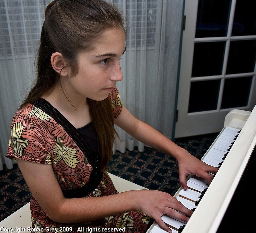 Downtown San Diego CA, USA.  Friday, May 29 2009:  Melody Makers Music Group founder, Katie O'Nell (12) plays the piano for a group of residents at the St. Paul's Villa Assisted Living Center, on Fourth Ave. in Downtown San Diego.  The Melody Makers Music Group is a group of children who play music at San Diego retirement homes on the last Friday of almost every month.  The group was founded by Katie O'Nell in 2007.   O'Nell (12) organises the performances and emcees each event.