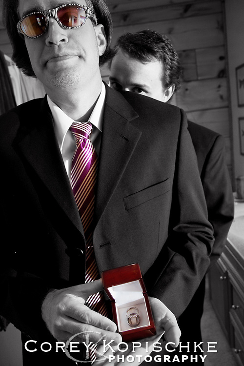 Groom and best man with wedding ring prior to ceremony.