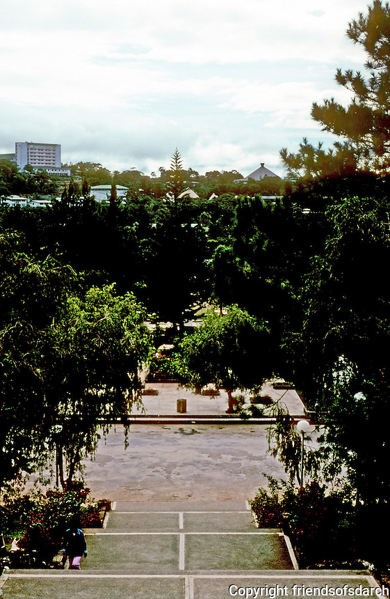 Philippines: Baguio--looking to Burnham Park from steps to City Hall.  Park view blocked by trees. Photo '82.