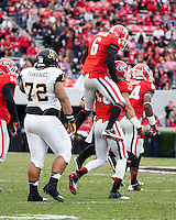 The Georgia Bulldogs beat the App State Mountaineers 45-6 in their homecoming game.  After a close first half, UGA scored 31 unanswered points in the second half.  Georgia players celebrate a fumble recovery