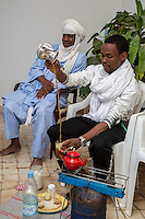 Nigerien Tuareg Pouring Tea, Biannual Arts Festival, Goree Island, Senegal.  Father and Son.