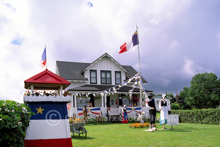 Bertrand, NB, New Brunswick, Canada - House decorated with Acadia Colours (Blue, White, and Red / Bleu, Blanc, Rouge) and Iconic Figures and Lighthouse, for the Annual Acadian Festival