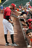 Houston Astros OF Hunter Pence signs autographs before his game against the Philadelphia Phillies on Sunday April 11th, 2010 at Minute Maid Park in Houston, Texas.  (Photo by Andrew Woolley / Four Seam Images)