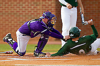 Brad Elwood (9) of the Charlotte 49ers slides into home plate ahead of the tag from Spencer Angelis (11) of the High Point Panthers at Willard Stadium on February 20, 2013 in High Point, North Carolina.  The 49ers defeated the Panthers 12-3.  (Brian Westerholt/Four Seam Images)