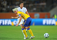 Abby Wambach (l) of team USA and Nilla Fischer of team Sweden during the FIFA Women's World Cup at the FIFA Stadium in Wolfsburg, Germany on July 6thd, 2011.