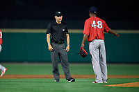 Pawtucket Red Sox pitcher Jenrry Mejia (48) argues a call with umpire Dan Merzel during an International League game against the Rochester Red Wings on June 28, 2019 at Frontier Field in Rochester, New York.  Pawtucket defeated Rochester 8-5.  (Mike Janes/Four Seam Images)