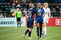 TACOMA, WA - JULY 31: Tziarra King #23 and Jessica Fishlock #10 of the OL Reign during a game between Racing Louisville FC and OL Reign at Cheney Stadium on July 31, 2021 in Tacoma, Washington.