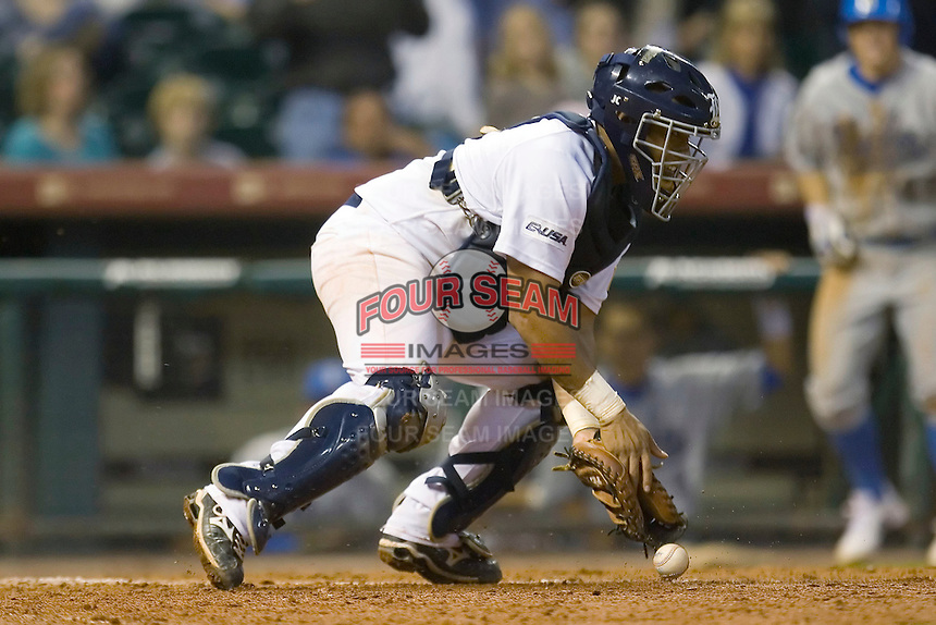 Catcher Diego Seastrunk #5 of the Rice Owls tries to stop a low throw at home plate versus the UCLA Bruins in the 2009 Houston College Classic at Minute Maid Park February 27, 2009 in Houston, TX.  The Owls defeated the Bruins 5-4 in 10 innings. (Photo by Brian Westerholt / Four Seam Images)