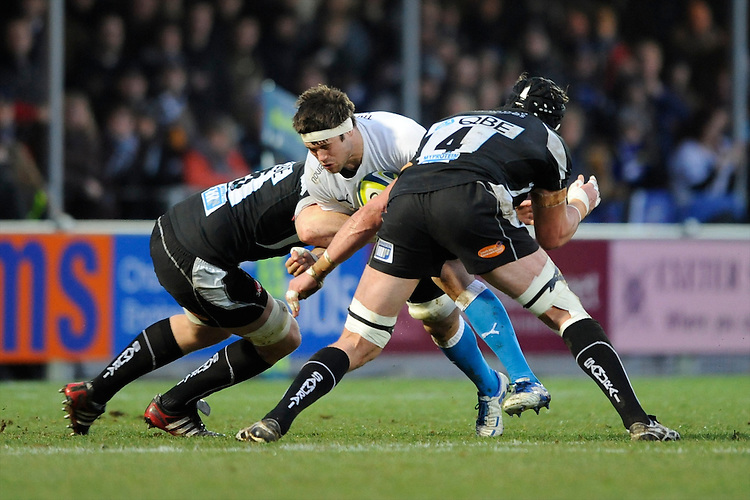 Guy Mercer of Bath Rugby is tackled by Peter Short (right) and James Hanks of Exeter Chiefs during the LV= Cup match between Exeter Chiefs and Bath Rugby at Sandy Park Stadium on Sunday 5th February 2012 (Photo by Rob Munro)