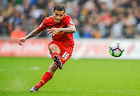 Phillippe Coutinho hits a free kick at The Liberty Stadium on October 1, 2016 in Swansea, Wales, nduring their game against Swansea.