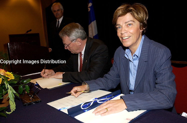 June 3, 2002, Montreal, Quebec, Canada; <br /> <br /> Louis Beaudoin, Quebec State Minister, International Relations (R)<br />  Richard Pound, Chairman of the World Anti-<br /> Doping Agency (L)<br /> sign an agreemeent regarding the Agency's new headquarter in Montreal, June 3, 2002<br /> <br /> <br /> <br /> <br /> (Mandatory Credit: Photo by Sevy - Images Distribution (©) Copyright 2002 by Sevy<br /> <br /> NOTE :  D-1 H original JPEG, saved as Adobe 1998 RGB