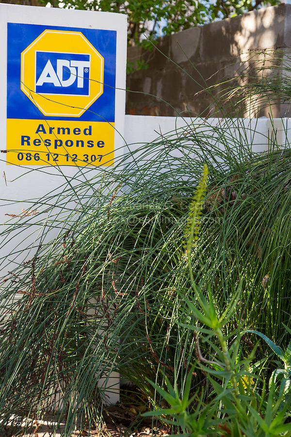 South Africa, Franschhoek.  Security Alarm Service Sign in front of Residence.