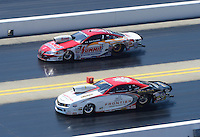 Apr. 14, 2012; Concord, NC, USA: NHRA pro stock driver Greg Stanfield (near lane) races alongside Greg Anderson during qualifying for the Four Wide Nationals at zMax Dragway. Mandatory Credit: Mark J. Rebilas-