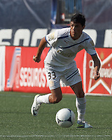 C.D. Olimpia midfielder Ramio Bruschi (33) on the attack. In an international friendly, AC Milan defeated C.D. Olimpia, 3-1, at Gillette Stadium on August 4, 2012.