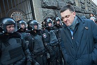 """Oleh Tyahnybok - leader All-Ukrainian Union """"Svoboda"""" gives police a smirk of disgust as he denied to enter the building of Ministry."""
