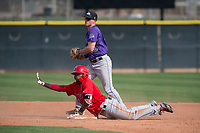 Los Angeles Angels outfielder Jose Verrier (74) asks for time after sliding safely under the tag of Bret Boswell (90) during a Minor League Spring Training game against the Colorado Rockies at Tempe Diablo Stadium Complex on March 18, 2018 in Tempe, Arizona. (Zachary Lucy/Four Seam Images)