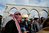 Jerusalem, Israel<br /> January 22, 1988<br /> <br /> Palestinians demonstrate against Israeli repression in the occupied territories after Friday ceremonies at the Dome of the Rock. They raise the Koran and a Palestinian flag in defiance.