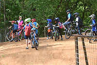 NEW PEDALS TO PUSH<br />Young riders and their coaches take a break Wednesday June 9 2021 on their bikes during a youth cycling camp at Coler Mountain Bike Preserve in Bentonville. Oz Kids Summer Camps for youth cyclists age 5 to 9 will take place through mid August at the Coler preserve. Buddy Pegs youth cycling program, on Wishing Spring Road in Bentonville, runs the camps, said Greg Vogel with Buddy Pegs. For details visit buddypegs.com. Go to nwaonline.com/210610daily/ to see more photos.<br />(NWA Democrat-Gazette/Flip Putthoff)