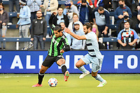 KANSAS CITY, KS - MAY 9: Cecilio Dominguez #10 Austin FC shields the ball from Graham Zusi #8 Sporting KC during a game between Austin FC and Sporting Kansas City at Children's Mercy Park on May 9, 2021 in Kansas City, Kansas.