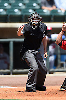 Home plate umpire Alex Ziegler makes a call during a game between the Tennessee Smokies and Birmingham Barons on April 21, 2014 at Regions Field in Birmingham, Alabama.  Tennessee defeated Birmingham 10-5.  (Mike Janes/Four Seam Images)