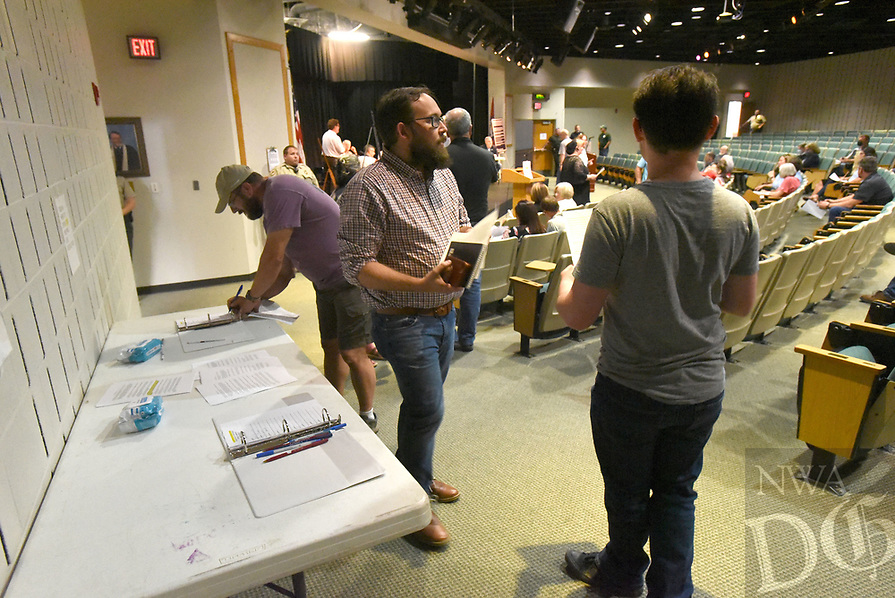 People sign up to speak Tuesday July 20 2021 during the Benton County Quorum Court committee of the whole meeting at Northwest Arkansas Community College.<br />(NWA Democrat-Gazette/Flip Putthoff)