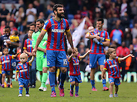 Pictured: Mile Jedinak of Crystal Palace joined by his children thanks supporters after the end of the game<br />
