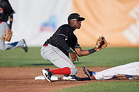 Batavia Muckdogs shortstop Demetrius Sims (3) receives a throw from the catcher on a stolen base attempt during a game against the Auburn Doubledays on June 15, 2018 at Falcon Park in Auburn, New York.  Auburn defeated Batavia 5-1.  (Mike Janes/Four Seam Images)