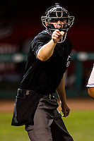 Home Plate Umpire Seth Buckmister calls a strike during a game between the Tulsa Drillers and the Springfield Cardinals at Hammons Field on July 19, 2011 in Springfield, Missouri. Tulsa defeated Springfield 17-11. (David Welker / Four Seam Images)