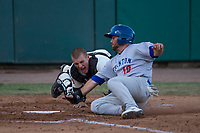 Visalia Rawhide catcher Daulton Varsho (9) applies the tag to Nate Mondou (10) during a California League game against the Stockton Ports at Visalia Recreation Ballpark on May 8, 2018 in Visalia, California. Stockton defeated Visalia 6-2. (Zachary Lucy/Four Seam Images)