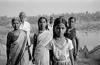 Family of pilgrims arriving in Hampi, South India after the funeral of a family member. <br /> Hampi, India, 2012.