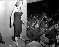 """Marilyn Monroe, motion picture actress, appearing with the USO Camp Show, """"Anything Goes,""""  poses for the shutterbugs after a performance at the 3rd U.S. Inf. Div. area.  February 17, 1954.  Cpl. Welshman.  (Army)"""