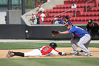 Scott Van Slyke #18 of the Chattanooga Lookouts playing first base as Miguel Rojas #11 of the opposing team slides back into first base  during a game against the Carolina Mudcats on May 22, 2011 at Five County Stadium in Zebulon, North Carolina. Photo by Robert Gurganus/Four Seam Images.
