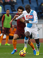 Napoli's Kalidou Koulibaly, right, is challenged by Roma's Mohamed Salah during the Italian Serie A football match between Roma and Napoli at Rome's Olympic stadium, 4 March 2017. <br /> UPDATE IMAGES PRESS/Riccardo De Luca