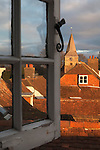 United Kingdom, England, East Sussex, Burwash: view through open window over rooftops of Burwash village