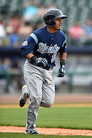 Corpus Christi Hooks catcher Rene Garcia (15) runs to first during a game against the NW Arkansas Naturals on May 26, 2014 at Arvest Ballpark in Springdale, Arkansas.  NW Arkansas defeated Corpus Christi 5-3.  (Mike Janes/Four Seam Images)