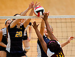 Perryville's Emily Merklinger and Kira Barret block a shot during the Perryville High School versus Dunbar High School match in the Semifinals of the Maryland State Volleyball 1A Championship at Ritchie Coliseum in College Park, Maryland on November 12, 2012. Perryville defeated Dunbar 25-21, 25-7 and 25-22 in straights sets to earn a rematch with Smithsburg for the State 1A Title.