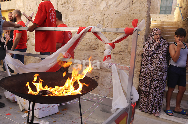 Christian worshippers take part in the Holy Fire ceremony in Bethlehem's Church of the Nativity in the Israeli-occupied West Bank, on May 1, 2021, on the eve of Orthodox Easter. Photo by Mosab Shawer