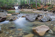 """The Baby Flume in Franconia Notch State Park of Lincoln, New Hampshire USA during the spring months. This natural feature is located on the Pemigewasset River just below the """"The Basin"""" viewing area."""