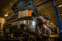 Automotive Technology student Mallory Hanna works on a brake assembly during instructor Randal Smith's brake systems (ADT A150) course in UAA's Automotive and Diesel Technology Building.