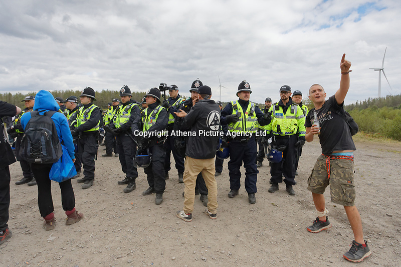 Pictured: Police officers speak to revellers. Monday 31 August 2020<br /> Re: Around 70 South Wales Police officers executed a dispersal order at the site of an illegal rave party, where they confiscated sound gear used by the organisers in woods near the village of Banwen, in south Wales, UK.