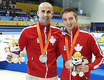 Toronto, Ontario, August 12, 2015. Benoit Huot wins silver and Alexander Elliot wins bronze  in the swimming during the 2015 Parapan Am Games . Photo Scott Grant/Canadian Paralympic Committee