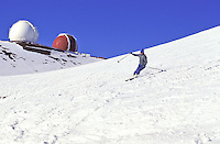 Skiers on Mauna Kea volcano on the Big Island of Hawaii. Highest mountain in the state of Hawaii