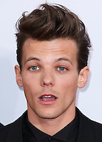 LOS ANGELES, CA, USA - NOVEMBER 23: Louis Tomlinson, One Direction arrives at the 2014 American Music Awards held at Nokia Theatre L.A. Live on November 23, 2014 in Los Angeles, California, United States. (Photo by Xavier Collin/Celebrity Monitor)